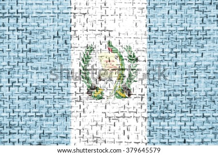 The concept of national flag on canvas jute fabric background: Guatemala