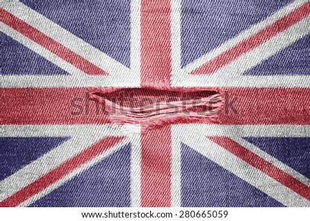 The concept of national flag on denim background with a hole: UK