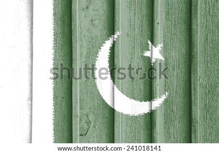 The concept of national flag on old ribbed wooden background: Pakistan - stock photo
