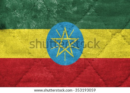 The concept of national flag on stitched canvas background: Ethiopia