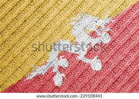 The concept of national flag on wool background: Bhutan