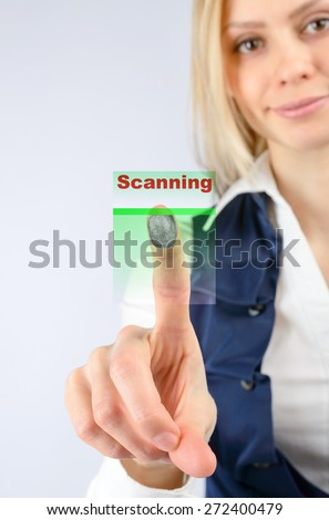 The concept of security. Business woman scans the fingerprint. design elements - stock photo