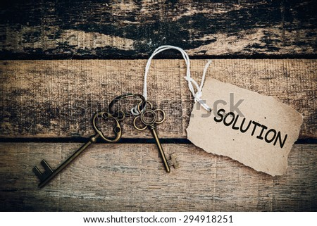 The concept of 'solution' is translated by key and silver key chain - stock photo