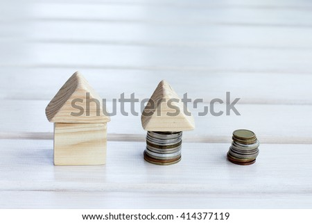the concept of the impact of the amount of money on real estate/Plan mortgage payments - stock photo