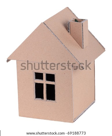 The concept, the house from the goffered cardboard, isolated on a white background