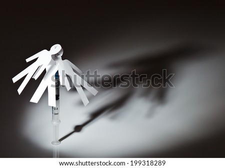 The conceptual image on a theme of narcotic dependence, white reflective background. - stock photo