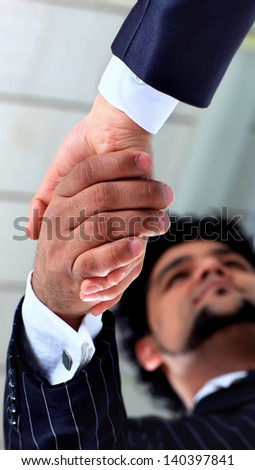 The conclusion of the transaction. Handshake. - stock photo