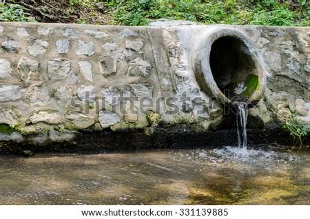 The concrete drainpipe or drainwater  - stock photo