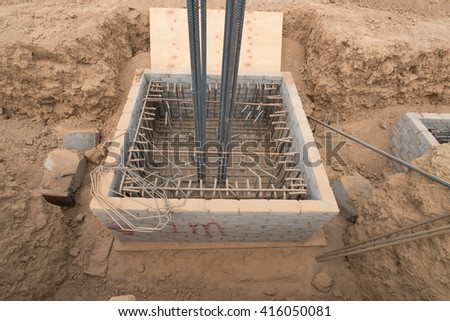 The concrete formwork and reinforcement steel for construction foundation. - stock photo