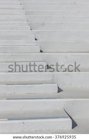 The concrete stair and handrail(banister) shadow in a public park(outdoor, exhibition, convention, play ground, stadium, arena) at the daylight.  - stock photo