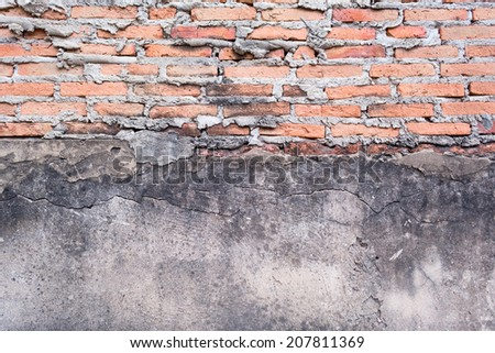 The concrete wall and red brick old age