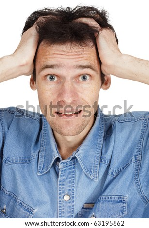 The confused young man has clasped hands a head isolated on white - stock photo