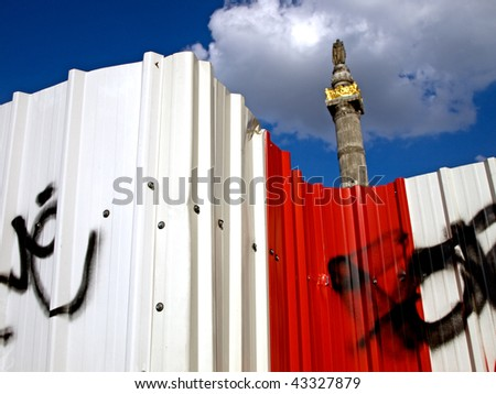 The Congress Column in Brussels, Belgium and white and red fence