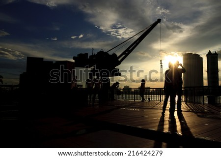 The construction crane on day with Twilight sky - stock photo