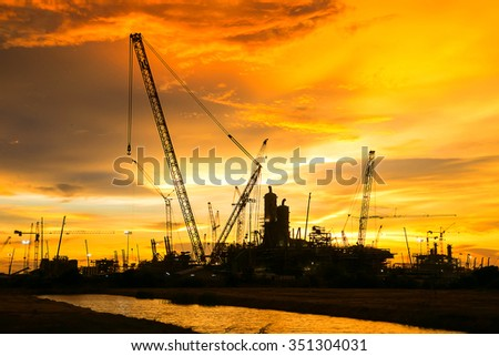The construction of a large oil refinery tank. - stock photo