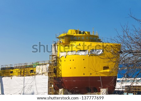 The construction of a new ship in dry dock shipyard