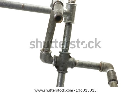 The construction of metal connectors and water pipes on a white background - stock photo