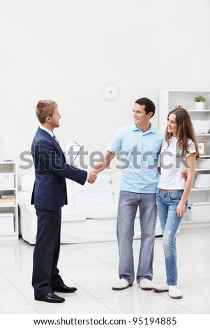 The consultant shakes hands with a man at home