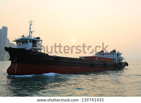 the container ship park  the hong kong harbor at sunset with coastline background