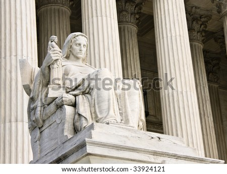 """The """"Contemplation of Justice"""" statue by James Earle Fraser, sculptor. This statue sits on the West fa?ade of the Supreme Court building in Washington DC. - stock photo"""