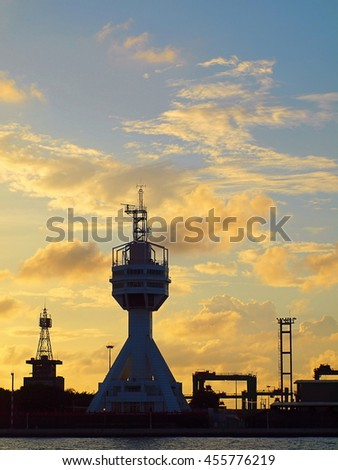 The control tower guarding the entrance to Kaohsiung port at dusk
