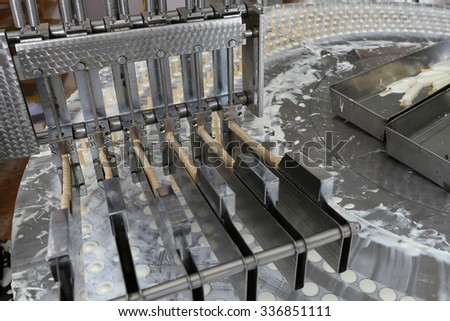 The conveyor automatic lines for the production of ice cream - stock photo