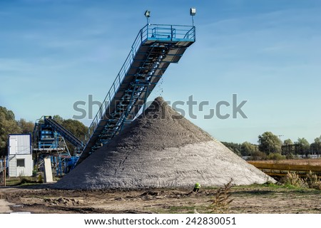 The conveyor belt of sand in gravel pit - stock photo