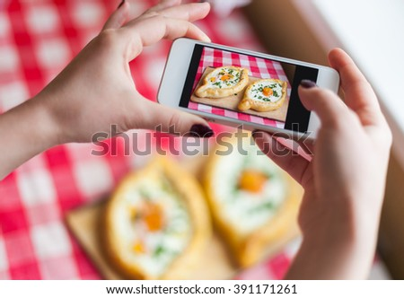 The cook photographs fresh fried traditional Georgian dish khachapuri - stock photo