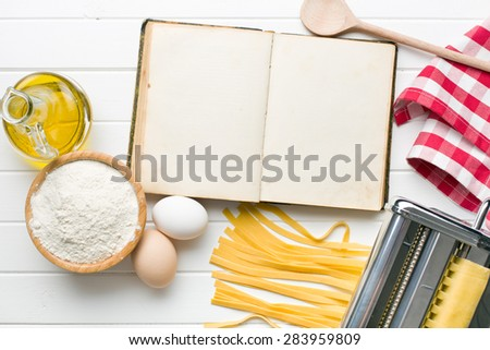 the cookbook and pasta ingredients - stock photo