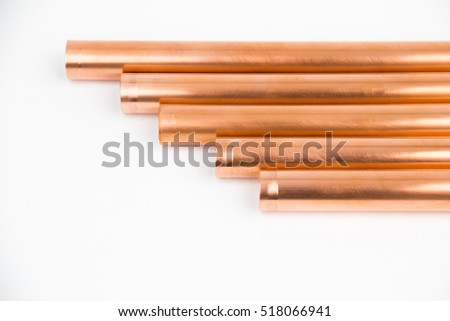 The copper pipes on the white background