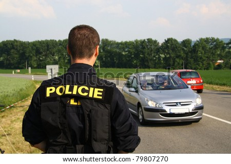 The copper stops the car - stock photo