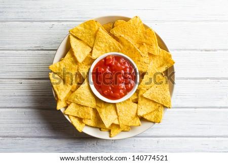 the corn nachos with tomato dip - stock photo