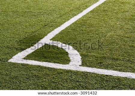 The corner boundary line of a soccer field.
