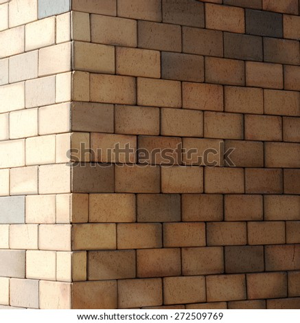 The corner of a brick wall with diminishing perspective texture background - stock photo