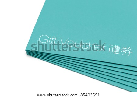 The corner of a stack of gift voucher in green, with Chinese translation printed on - stock photo
