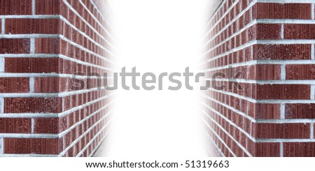 The corners of brick walls ascending into blank white copyspace - stock photo