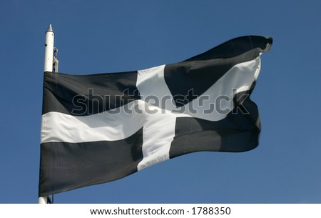 The Cornish flag blowing in the wind - stock photo