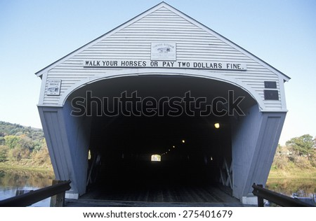 The Cornish-Windsor bridge connecting Vermont and New Hampshire is the world's longest covered bridge at 460 feet. The bridge was built in 1866 - stock photo