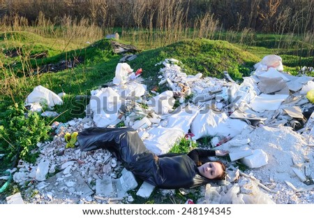 The corpse of a girl in a packet at the dump - stock photo