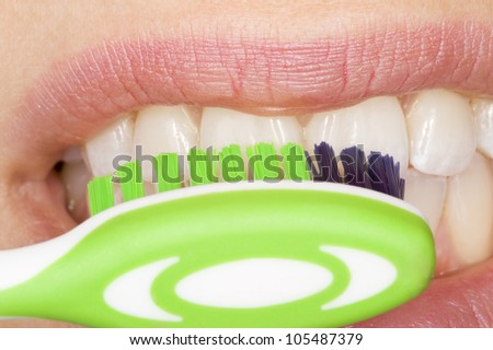 the correct use of a tooth brush for perfect oral hygiene - stock photo