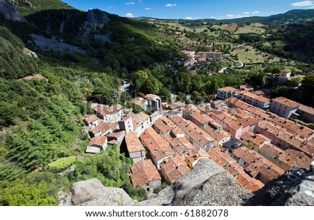 The country of Roccalbegna seen from the top of a rocky spur that dominates the village