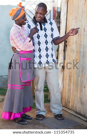 The couple are showing the way to their new home. - stock photo