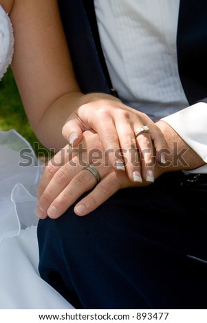 the couple displays the rings