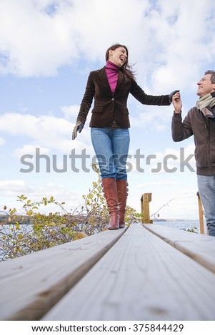 the couple holding hands - stock photo