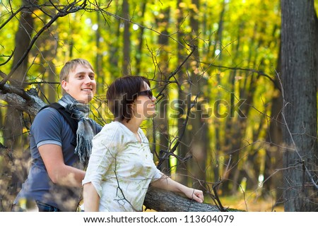 the couple in an autumn wood - stock photo