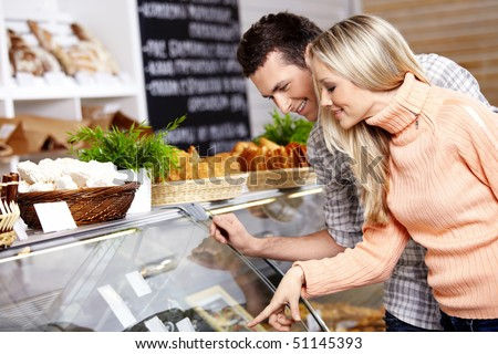 The couple specifies in purchase in shop - stock photo
