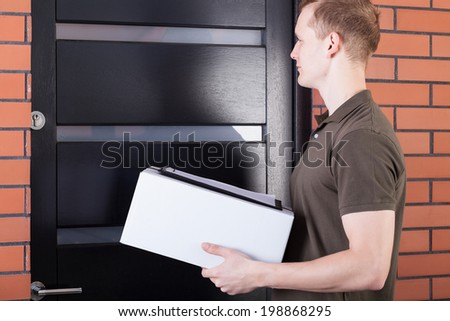 The courier waiting outside the door of the box and documents