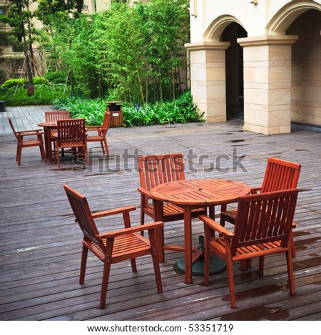 the courtyard of an house outdoor in the rain. - stock photo