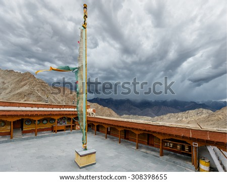 The courtyard with the ritual pole with flags in Likir Gompa (monastery) - Tibet, Leh district, Ladakh, Himalayas, Jammu and Kashmir, Northern India - stock photo