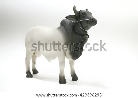 The cow with low light and white background , animal in white tone